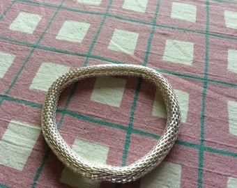 Silver coloured bracelet