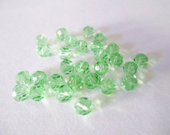 20 rondelle faceted light green glass 4mm beads