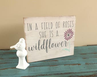 In a Field of Roses she is a Wildflower Rustic Hand Painted Wood Sign/Wall Decor/Nursery Decor/Gallery Wall Sign/Girl Nursery Sign