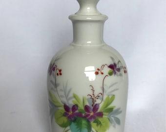 A hand painted porcelain scent bottle