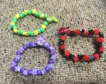 Set of three bug kandi bracelets