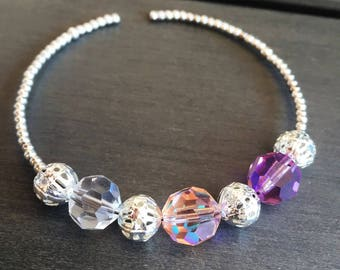 Bangle is silver with swarovski crystals