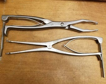 Pair of Orthopedic surgeons tools, bone surgery tools stainless surgical tools/instruments compressor distractor