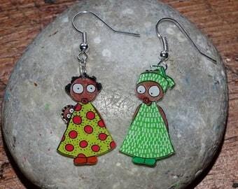 African women in colorful dresses earrings