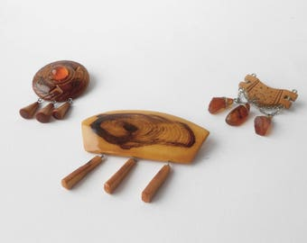 Vintage wooden brooches with charms