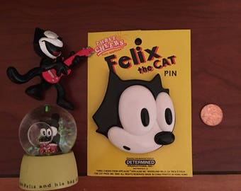 Felix The Cat Figure, Pin, and Snowglobe