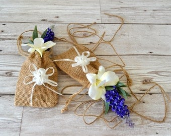 6. Wedding decorations.Chair/Pew ends.Hessian bags.lavender.ivory orchid