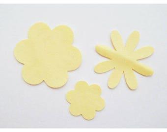 Set 3 yellow leatherette flower motifs