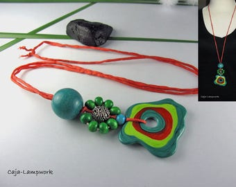 Long necklace with colored glass bead
