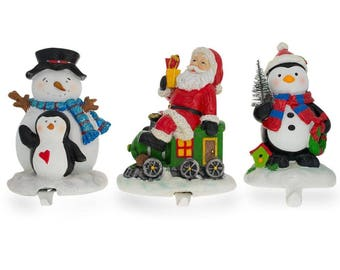 "6.5"" Set of 3 Hand Painted Stocking Holders - Penguin, Snowman & Santa"