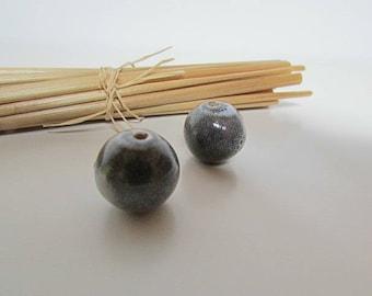 2 beads grey ceramic - 16 mm hole 2 mm - 447.7