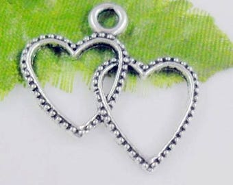 2 silver and hammered double heart charms