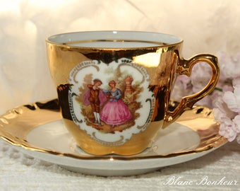 J. K. W. Bavaria, Western Germany: Gold demitasse with a scene of a couple, signed by Fragonard