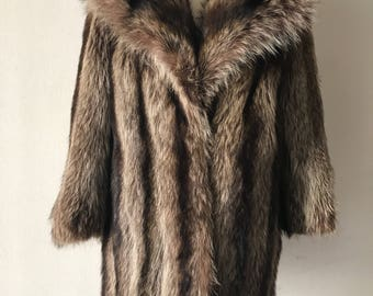 Raccoon fur coat woman size small .