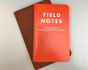 Field notes or moleskine pocket leather journal cover with space pen