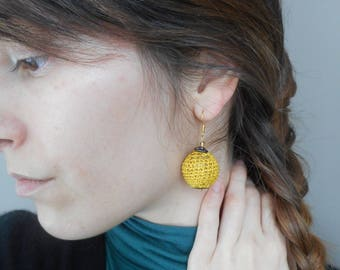 Mustard crocheted ball earrings.