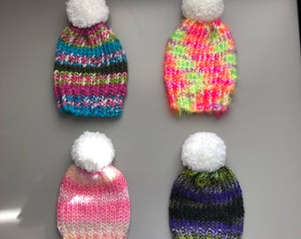 Your choice babybgirls knitted hats, size 9-18 months. Knitted hat, toddler hat, pom pom