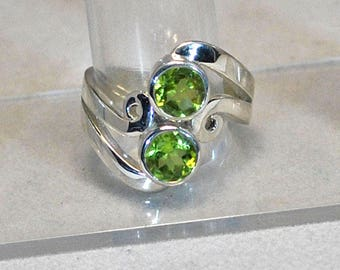 Silver ring with peridots