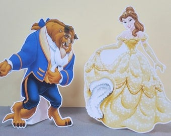 """large a4 die cut shapes inspired by characters in """"beauty and the beast"""" to decorate the table"""