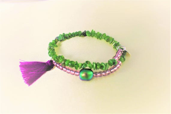 boho chic bracelet gemstones: tsavorite, Pearl swarovski pearls, seed beads and charms