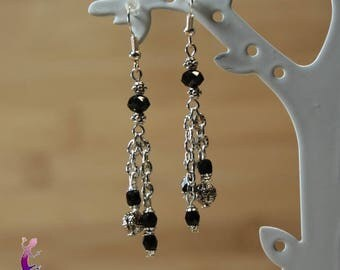 Earrings in silver and black glass beads