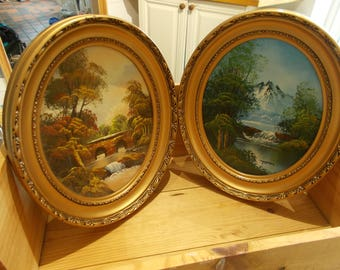 2 vintage oval frames with oils