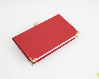 Protects checkbook / checkbook holder in red canvas