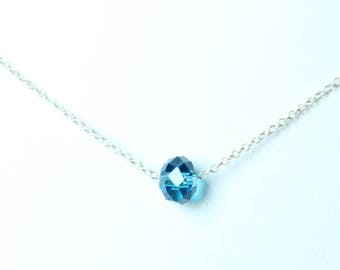 Crew neck silver and blue faceted glass bead