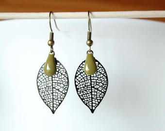 Featuring a black filigree leaf and sequin enameled khaki green drop clip earrings