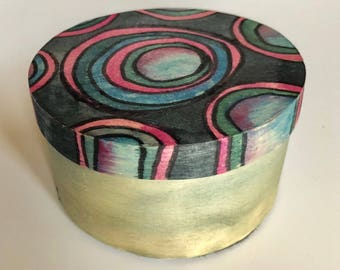 wooden box with Concentric circular design in blues, pinks and purples