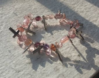 Pink and purple bead bracelet with cross charms
