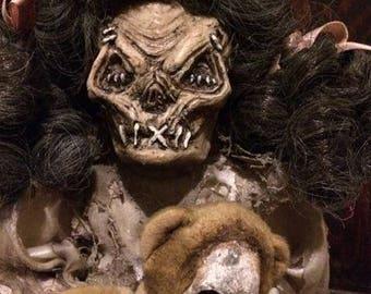 Skull face doll