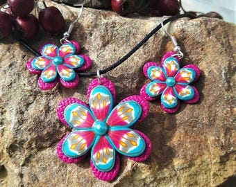 Pink and blue flowers set made of polymer clay.