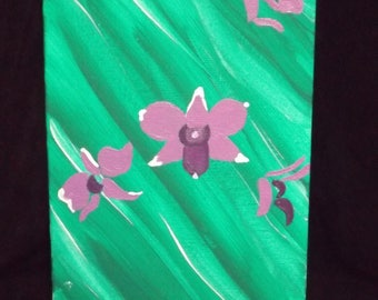 purple orchid on emerald green
