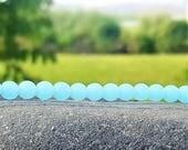 Perles rondes cultured sea glass, verre recyclé, Opaque seafoam bleu, 6 mm, 34 pcs