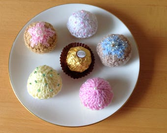 A set of five tea time fancy cakes, hand knitted to cover a Ferrero Rocher chocolate.