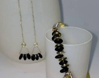 Black, gold, and Silver bangle bracelet and threader earring set.