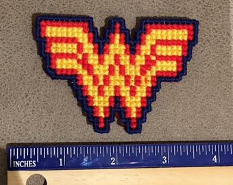 Wonder Woman fridge magnet, cross stitched onto plastic canvas, backed with felt.