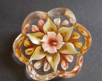 Flower shaped reverse carved lucite 1950s brooch with pink flowers