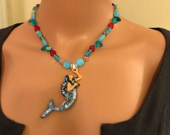 Raven haired ice princess mermaid necklace w blues , reds and greens 17 inches