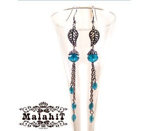 Long Chain Drop Earrings with silver leafs and blue crystals.