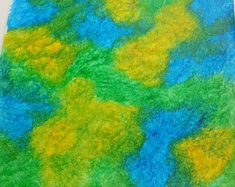 blue-green-yellow stippled paste paper