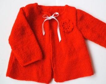 Orange vest with crochet flower