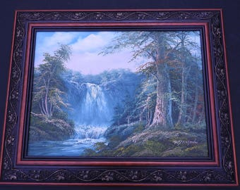 Oil on canvas of waterfall , ornate gilt fremed,signed