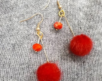 Pon pon and crystals, dangling earrings.