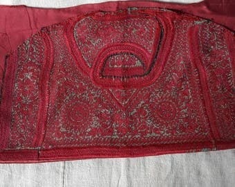Ethnic antique embroidery, a textile fragment aprox. 100 years old.