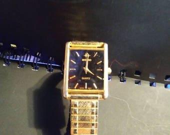 Gold toned Seiko watch