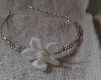 pair of white flowers and rhinestone headband