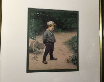 Mid century framed reproduction print of *The Young Biologist* by Paul Peel. Framed print of a young jewish boy in the garden.
