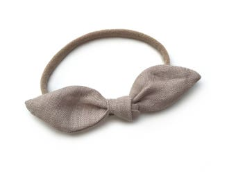Natural Linen Bow Headband on a one size fits all Nylon Band